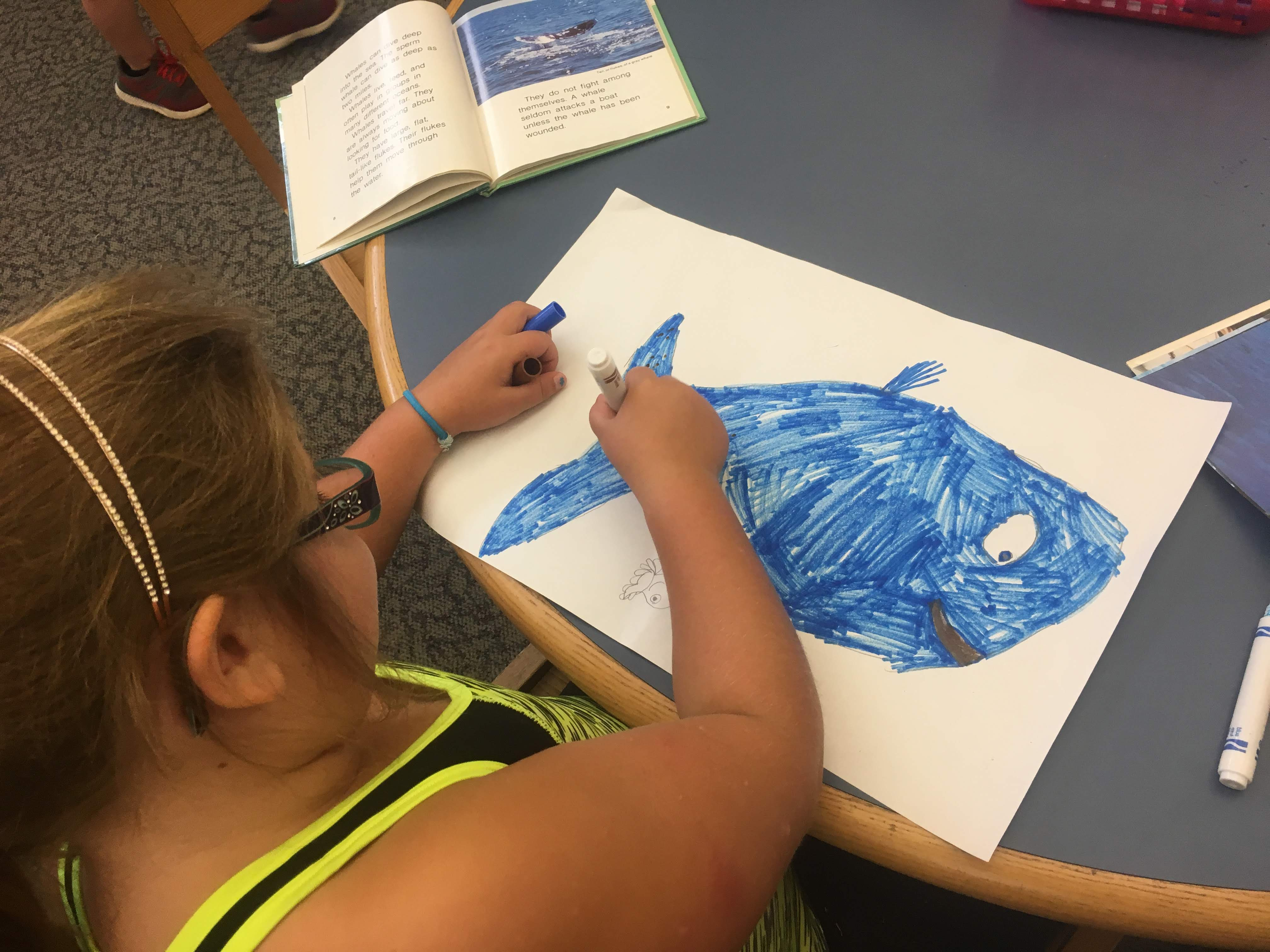 Student preparing her artwork during a fossil visit